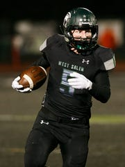 West Salem's Jacob Denning (5) runs with the ball in an OSAA Class 6A quarterfinal game on Nov. 17, 2017.