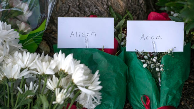 Flowers, balloons and cards are left for the staff of WDBJ as well as cards for Alison Parker and Adam Ward in front of WDBJ's location in Roanoke, Va., Aug. 26, 2015.