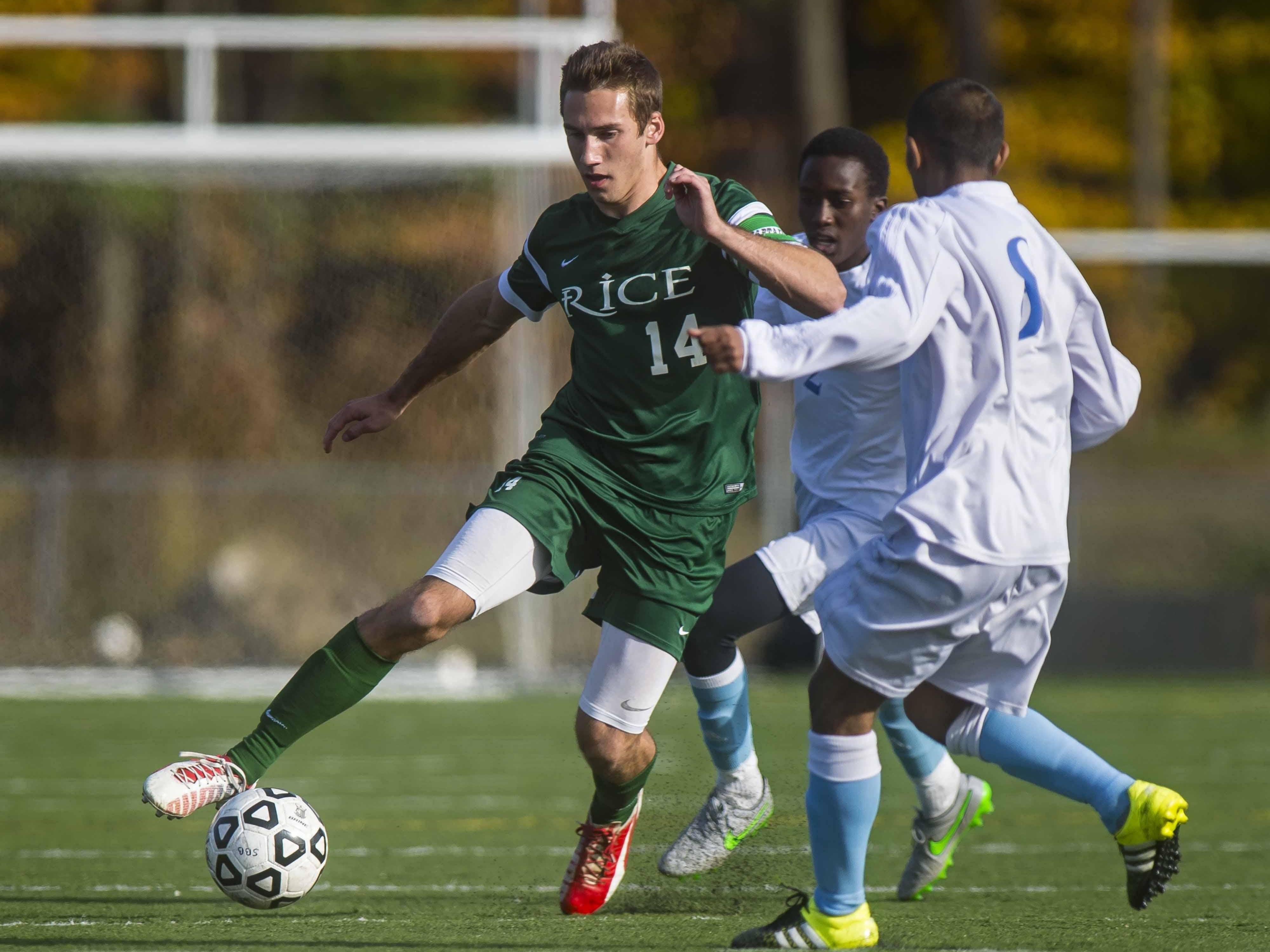 Rice Memorial's Clayton Scott, left, dribbles between South Burlington's Amza Issa and Rakesh Subedi, right, in a boys soccer semifinal earlier this week.