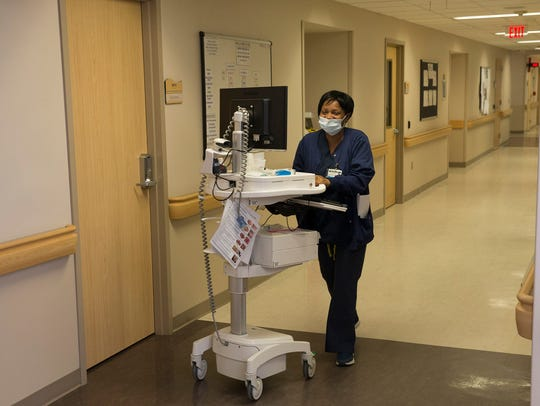 A nurse goes through the in-patient section of Barnabas