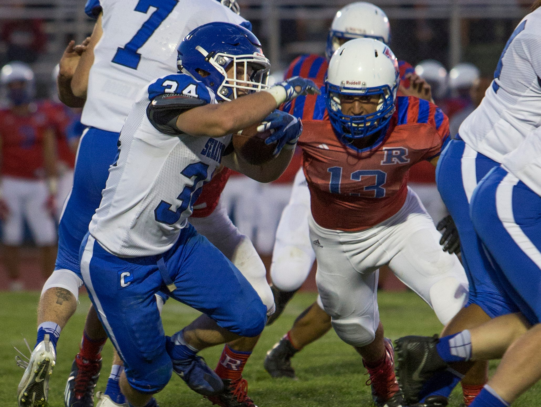 Carson's Abel Carter runs against Reno in a football game earlier this month at Reno.