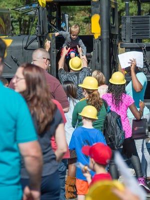 Children enjoying a recent Touch a Truck event.