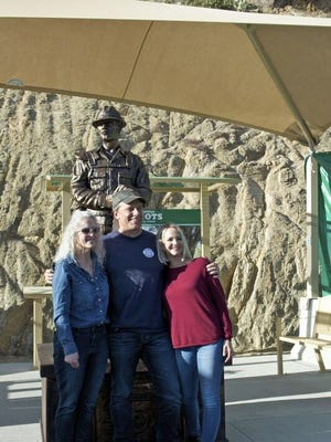 """Deborah Pfingston and Roxanne Preston with Dirty Jobs host Mike Rowe who featured the women's work to help wildland firefighters on his Facebook Watch series """"Returning the Favor""""."""