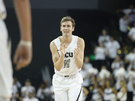 GCU's Casey Benson (11) claps for a teammate after