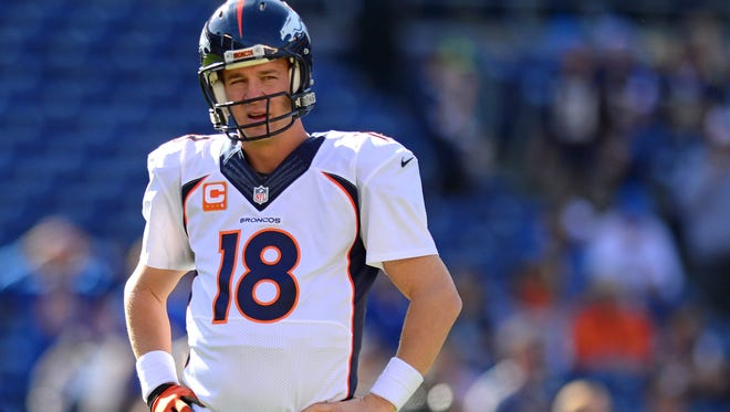 Broncos quarterback Peyton Manning looks on before Sunday's game against the San Diego Chargers.