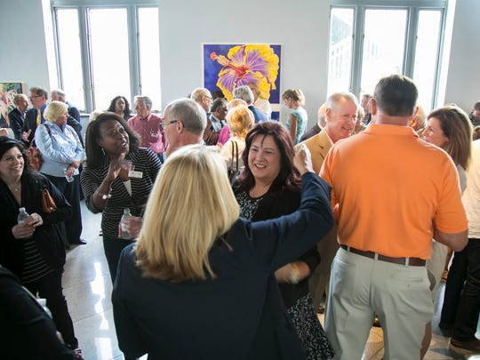 Guests greet one another at an event announcing the name of the new downtown Fort Myers hotel. It will be called Luminary Hotel & Co.