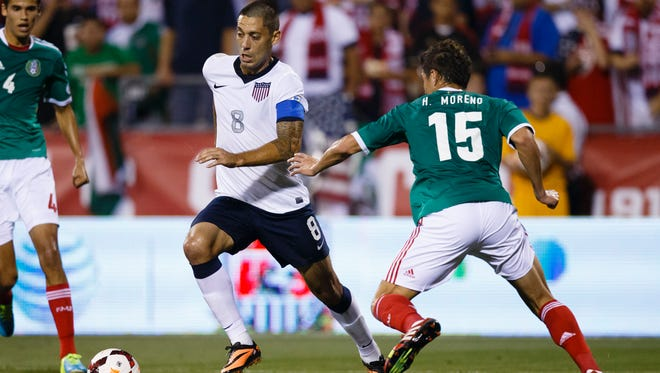 United States forward Clint Dempsey (8) is defended by Mexico defender Hector Moreno (15) during the first half at Columbus Crew Stadium on Tuesday.