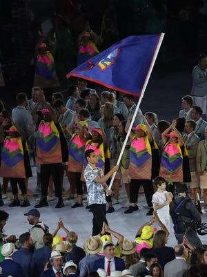 Benjamin Schulte arrives with Guam flag during the opening ceremonies for the Rio 2016 Summer Olympic Games at Maracana Aug. 5 in Rio de Janeiro, Brazil.