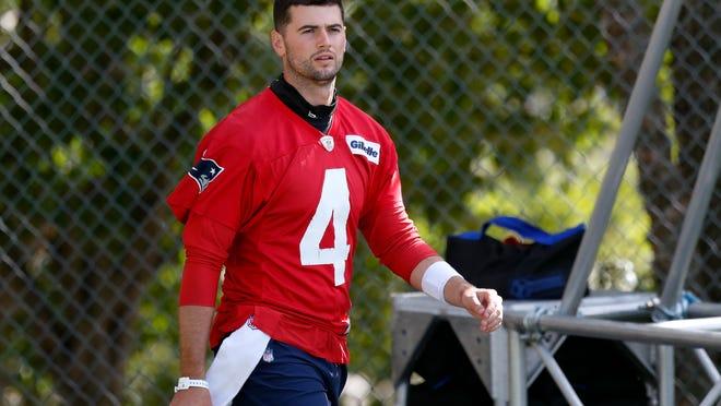 Patriots quarterback Jarrett Stidham walks to the field during training camp Friday at Gillette Stadium.