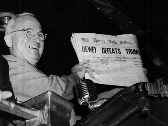 "FILE-- U.S. President Harry S. Truman holds up an Election Day edition of the Chicago Tribune which based on early results mistakenly announced ""Dewey Defeats Truman"", Nov. 4 1948."