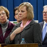 Debbie Ziegler, center, the mother of Brittany Maynard, speaks in support of proposed legislation allowing doctors to prescribe life-ending medication to terminally ill patients in California.