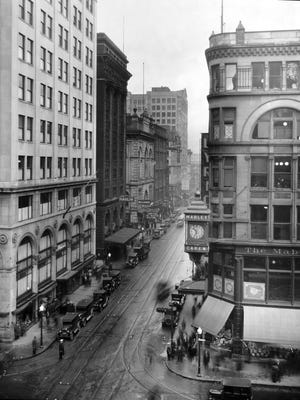 A moment in time along Vine Street, looking north from Fifth Street, was captured in February 1927.