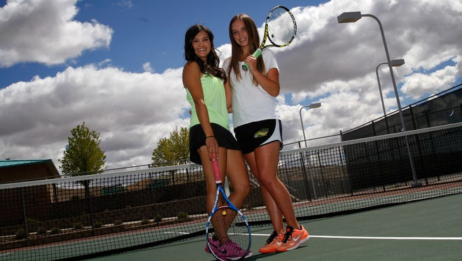 From left, Farmington's Riley Coleman and Hailie Nygren pose for a portrait on Monday at the Farmington Sports Complex.