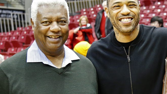 Former Bearcats great Oscar Robertson and Kenyon Martin pose for a photo after the NCAA men's basketball game between the Cincinnati Bearcats and the Memphis Tigers at Fifth Third Arena on the campus of the University of Cincinnati in Cincinnati on Thursday, Jan. 21, 2016. The Bearcats tallied a conference win, 76-72, over the Tigers.
