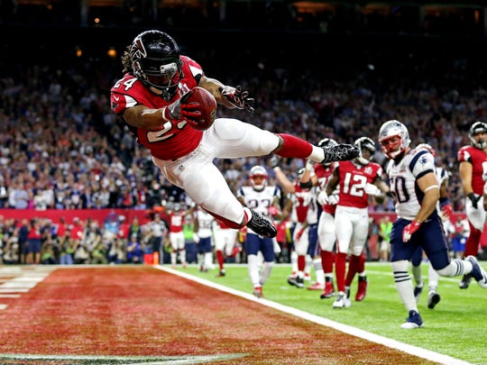 Atlanta Falcons running back Devonta Freeman scores a touchdown during the second quarter against the New England Patriots during Super Bowl LI at NRG Stadium.