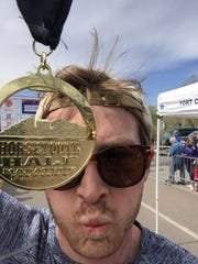 Jake Lord, who died in a climbing accident in July 2017, with his Horsetooth Half Marathon medal in 2017.