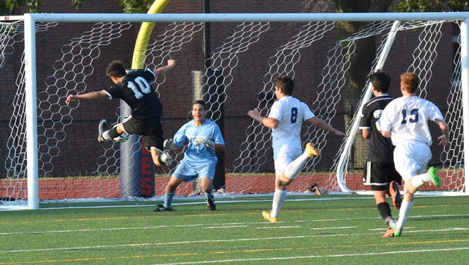A shot from Rye's Leo Gomes (10) is saved by Eastchester's Noah Weinbaum in the first half of a game on Tuesday, Sept. 8. Visiting Rye won, 2-1.