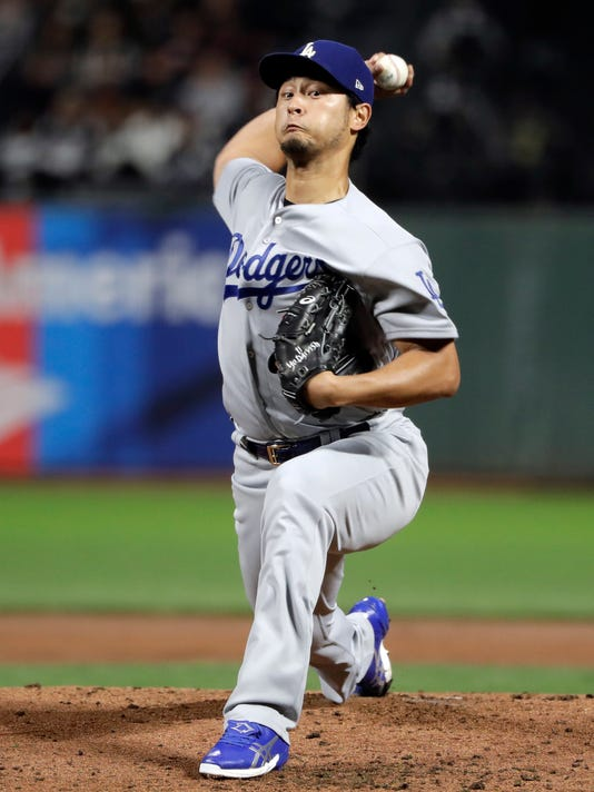 Los Angeles Dodgers starting pitcher Yu Darvish throws to a San Francisco Giants batter during the first inning of a baseball game Wednesday, Sept. 13, 2017, in San Francisco. (AP Photo/Marcio Jose Sanchez)