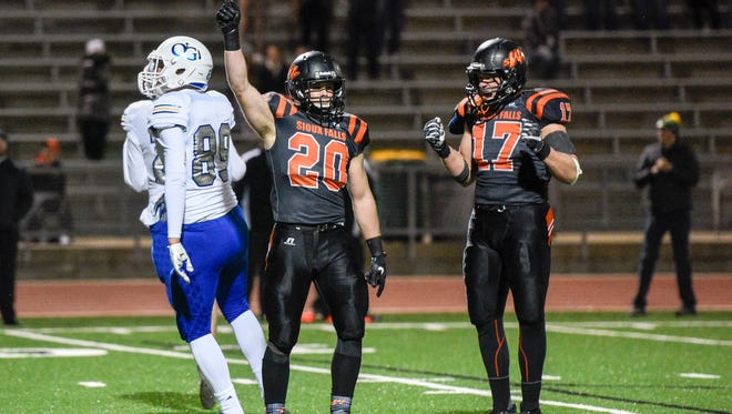 Washington kicker Brock Walker (20) celebrates kicking the game winning extra point against O'Gorman during the second half of their 11AAA state championship semifinal game on Friday, Nov. 3, 2017.