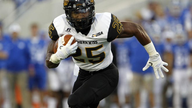 Southern Miss running back Ito Smith runs the ball against Kentucky in the Golden Eagles' season opener at Lexington Kentucky on Saturday.