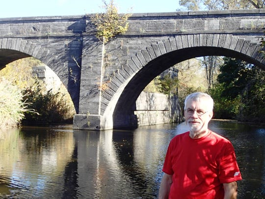 """Richard Allen, author of """"Reed Brown's 1841 Journey: America Through the Eyes of a Vermont Yankee,"""" at the Schoharie Crossing aqueduct in Fort Hunter, N.Y."""