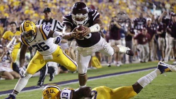 Mississippi State senior quarterback Dak Prescott takes