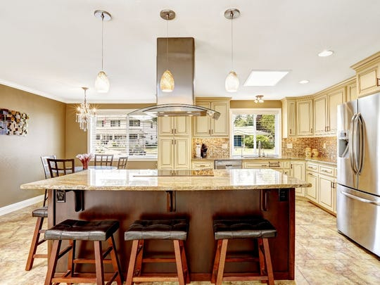 "The experts recommend investing in the big appliances that will be noticeable to guests and are the main features of the ""kitchen work"" triangle."