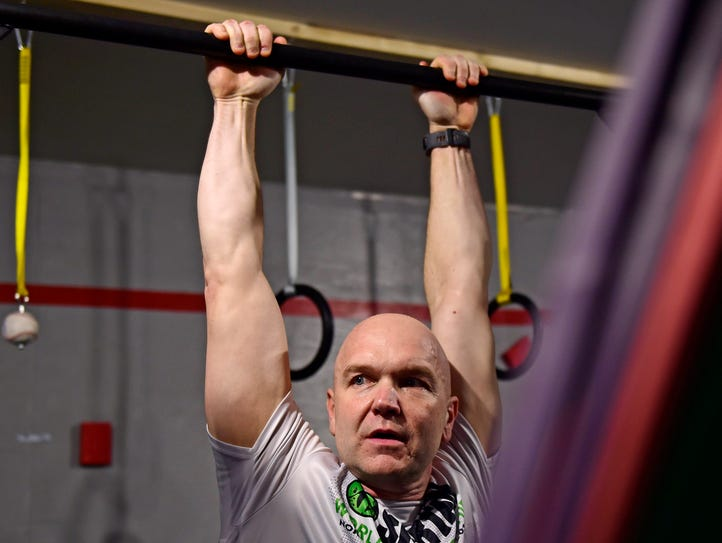 Andy Bell from Fairview Township completes a hang challenge