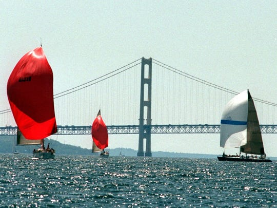 Yachts pass the Mackinac Bridge on July 24, 2000, nearing the finish line of the 93rd annual Chicago To Mackinac Yacht Race at Mackinac Island, Mich.