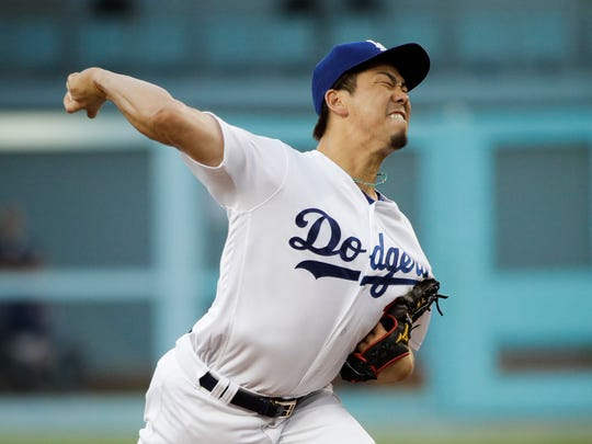 Los Angeles Dodgers starting pitcher Kenta Maeda, of Japan, throws against the Minnesota Twins during the first inning of a baseball game, Tuesday, July 25, in Los Angeles.