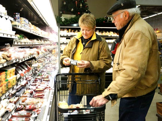 Leslie and Larry Sturzenberger of Maryland shop for cheese and bratwurst at Kenosha's Mars Cheese Castle while visiting Wisconsin December 21, 2016. Doug Raflik/USA TODAY NETWORK-Wisconsin