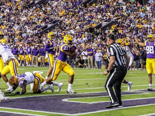 LSU running back Lanard Fournette scores a touchdown during the team's spring game.