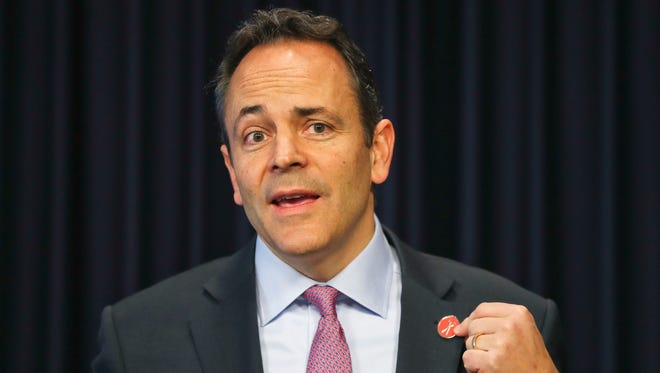 Gov. Matt Bevin spoke about his button, which he says is symbolic of his administration 'cutting the red tape' of government during his 2017 year in review to reporters in Frankfort Thursday morning.