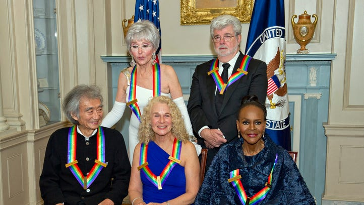 The five recipients of the 38th Annual Kennedy Center Honors pose for a group photo following a dinner hosted by US Secretary of State John Kerry, at the US Department of State in Washington on Dec. 5, 2015. In picture, the 2015 honorees are: US singer-songwriter Carole King (C, front), US filmmaker George Lucas (R, back), Puerto Rican actress and singer Rita Moreno (L, back), Japanese conductor Seiji Ozawa (L, front), and US actress and Broadway star Cicely Tyson (R, front).