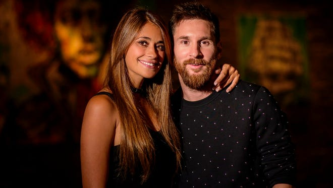 Handout picture released by Nueva Comunicacion showing Argentine football star Lionel Messi and bride Antonella Roccuzzo just before getting ready for their wedding in Rosario, Santa Fe province, Argentina on June 30, 2017.