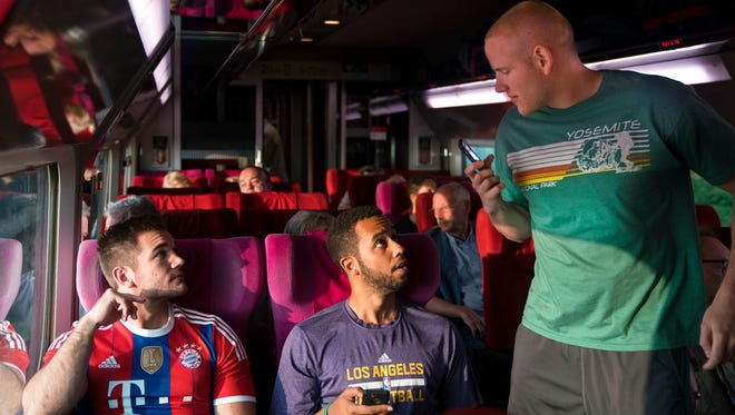 "From left, Spencer Stone, Anthony Sadler and Alex Skarlatos in a scene from ""The 15:17"" To Paris."" The movie opens Feb. 9 at Regal West Manchester Stadium 13, Frank Theatres Queensgate Stadium 13 and R/C Hanover Movies."