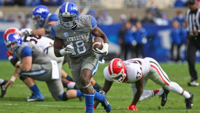 Kentucky's Boom Williams scored on this 56 yard run in the second quarter which sparked the crowd.. But it wasn't enough as Georgia rolled past the Wildcats 63-31. Nov. 8, 2014 By Matt Stone/The C-J