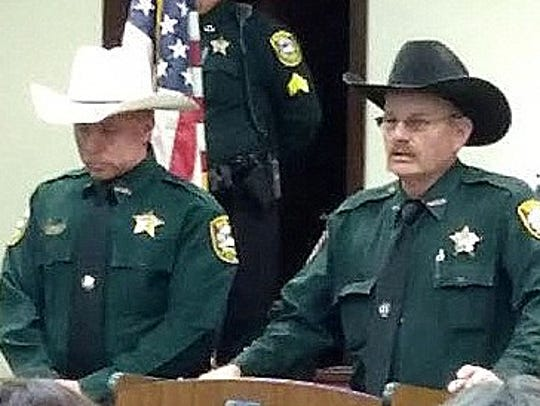 Lincoln County Sheriff Robert Shepperd, right, goes