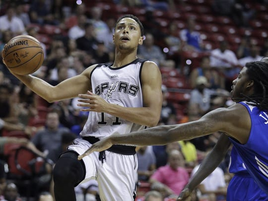 In this file photo, San Antonio Spurs' Bryn Forbes shoots around Philadelphia 76ers' Charles Jackson during the first half of an NBA summer league basketball game, Sunday, July 9, 2017, in Las Vegas.