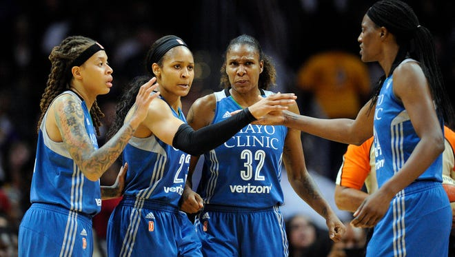 Minnesota Lynx forwards Maya Moore (23), Rebekkah Brunson (32), center Sylvia Fowles (34) and guard Seimone Augustus (33) react after a foul call against the Los Angeles Sparks during the first half in Game 4 of the WNBA Finals.