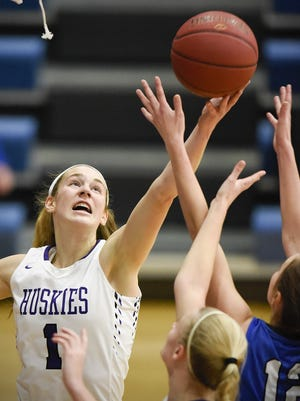 Albany's Madison Schmitz pulls in a rebound away from Sartell's Madalyn Schnettler Jan. 3 at Sartell. Schmitz, a 5-foot-11 forward, is headed to the College of St. Benedict to continue her basketball career.