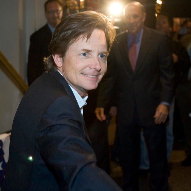 File: Actor Michael J. Fox greets supporters at a rally for Wisconsin Gov. Jim Doyle, right, Monday, Nov. 6, 2006, in Milwaukee. He urged the crowd to vote for candidates who support expanding embryonic stem cell research, such as Doyle.