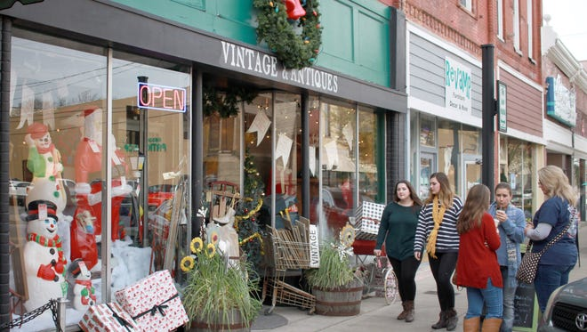 Gallatin shoppers take a look at the stores decorated for the holidays as part of Tinsel & Treasure on Sat. Nov. 11, 2017.