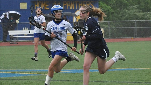 Pelham's Lucy Conway (r) carries the ball as Hen Hud's
