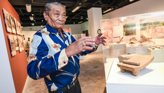 Agana Heights resident Francisco Perez Sablan, 76, describes how he would use a mano and metate, more commonly known as a grinding stone and platform during a visit to the Senator Antonio M. Palomo Guam Museum and Chamorro Educational Facility in Hagåtña on Friday, Dec. 9, 2016. Sablan explained that he used the basalt stone grinding tools, seen displayed in the lower right, when he was a young boy to crush corn kernels into corn flour to help his family make corn tortillas.