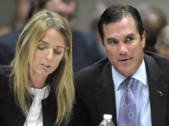 Defense co-council Britt Cobb, left, and her client,
