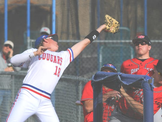 Cooper first baseman Jack Owens snags Austin Vaught's