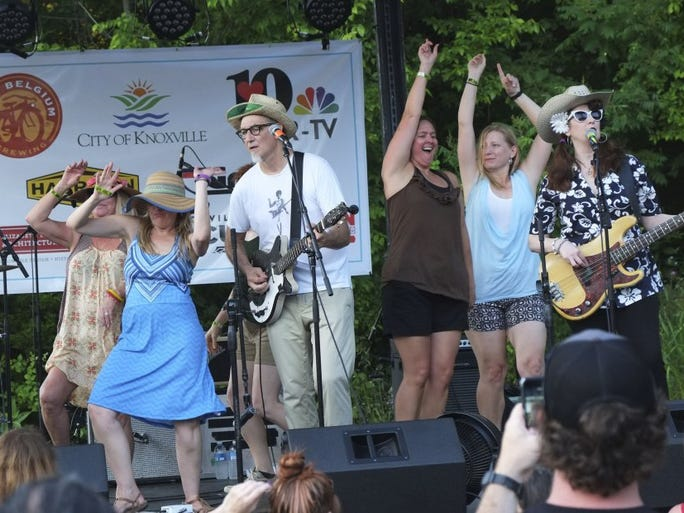 Guitarist Rick Miller and and bass player Mary Huff of Southern Culture on the Skids are joined on stage by audience members during the Meadowlark Music Festival Saturday, June 25, 2016, at Ijams Nature Center.