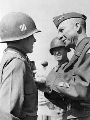 Staunton's Gen. Alexander M. Patch, commander of the U.S. Seventh Army, right, presents the Congressional Medal of Honor and the Legion of Merit Awards to Lt. Audie L. Murphy, 20, in 1945.