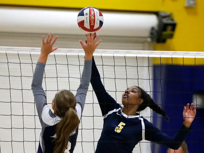 University School's Chyna Bacchus   gets the ball past